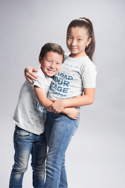 Asian Kids Wearing Round Neck Tees Mockup while Hugging a20934