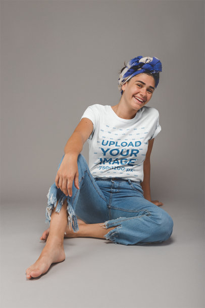 Young Girl Wearing a T-Shirt Mockup Sitting on a Photo Studio a20884