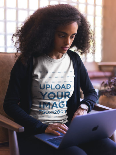 Black Woman Wearing a Round Neck Tee Mockup Working with a Laptop a20427