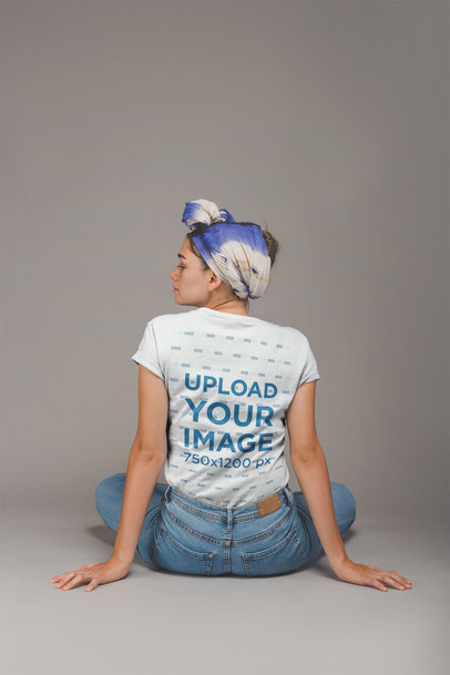 Back Shot of an Artist Wearing a T-Shirt Mockup Sitting on the Floor a20885