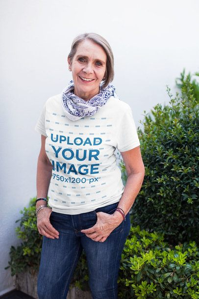 Senior Woman Wearing a Round Neck Tee Mockup Against Plants a20667