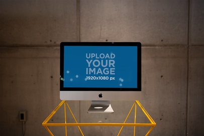 iMac Mockup Standing on a Small Glass Desk a21177