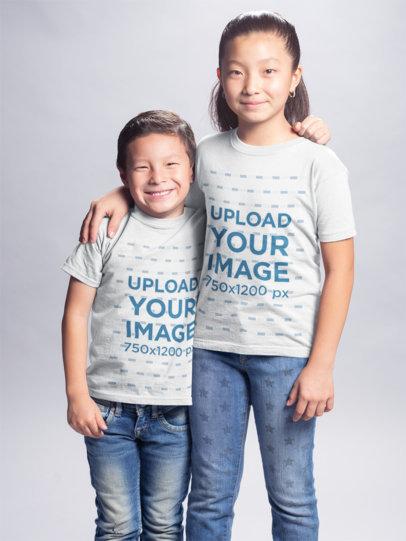 Asian Kids Wearing Tshirts Mockup Hugging at a Photo Studio a20936