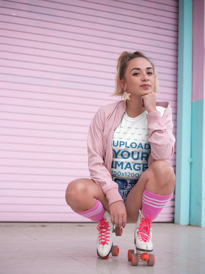 Trendy Woman with Roller Skates Wearing a T-Shirt Mockup in a Pink Environment a18561