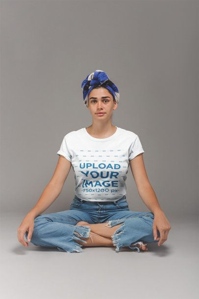Girl with a Headwrap Wearing a T-Shirt Mockup Sitting in Lotus Position a20859