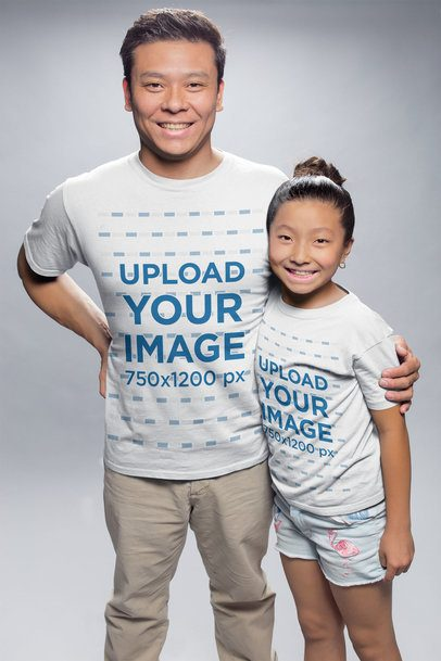 Mockup of an Asian Man Hugging his Daughter Wearing T-Shirts at a Photo Studio a20952