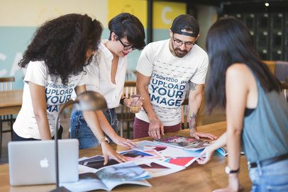 Team of Coworkers Wearing Round Neck Tees Mockup while Brainstorming a20434