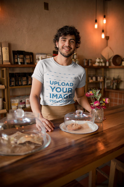 Mockup of a Coffee Shop Waiter Wearing a T-Shirt while Waiting for Customers a20474