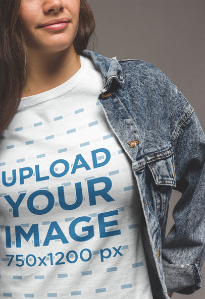 Close-Up T-Shirt Mockup of a Woman Wearing a Denim Jacket a20863