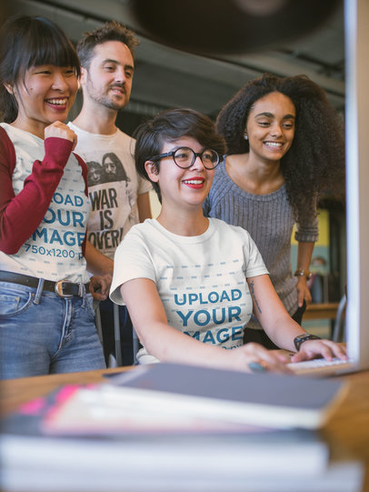 T-Shirt Mockup of Two Smiling Women with Coworkers at a Startup a20409
