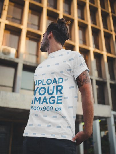 Sublimated Round Neck Tee Mockup Featuring a Long-Haired Man Outside a Big Building a19934