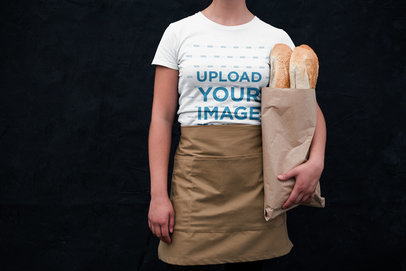 T-Shirt Mockup of a Woman Holding Baguettes and Wearing an Apron 20503a
