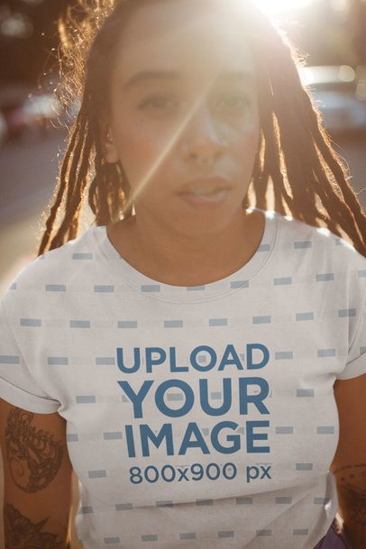 T-Shirt Mockup of a Young Black Woman Walking on Sunset a19757