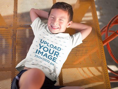 T-Shirt Mockup of a Happy Asian Kid in a Playground 20958a