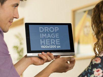 Overshoulder Shot Of Coworkers Sharing Lenovo Tablet