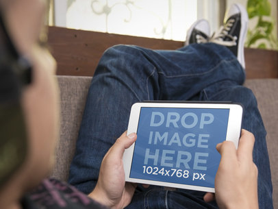 iPad Mockup Generator of Teenager Using iPad on the Couch