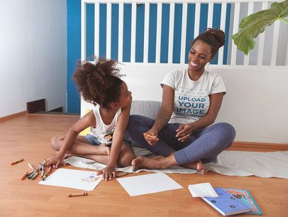 Mockup of a Happy Black Woman Wearing a T-Shirt Playing with her Daughter a21325