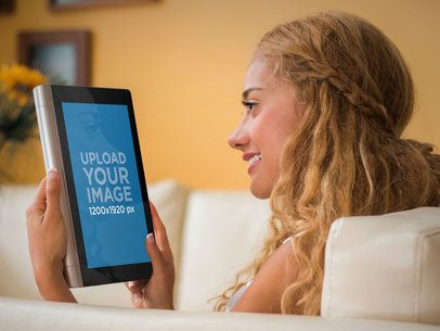 Young Woman Using Tablet on a Sofa Android Mockup