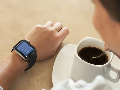 Young Lady on Coffee Break Wearing a Black Apple Watch Stock Photo