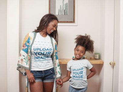 T-Shirt Mockup of a Happy Girl at Home with her Mom a21329
