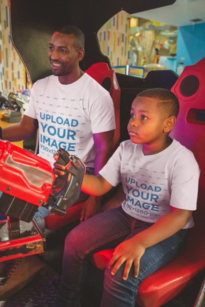 T-Shirt Mockup Featuring a Boy Playing with his Father at the Arcade a20545