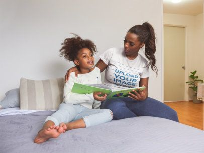 T-Shirt Mockup of a Woman Reading a Book with her Daughter a21321