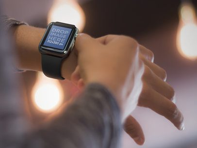 Close-up of a Young Man Using his Apple Watch Out at Night