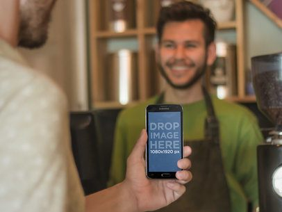 Young Man Using Android Phone at Coffee Shop Mockup Template
