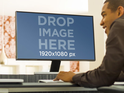 Young Man Working on Desktop Samsung PC Mockup