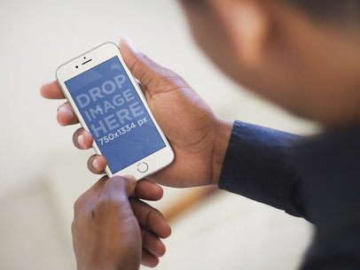 Mockup Template of Executive Man Using a White iPhone 6