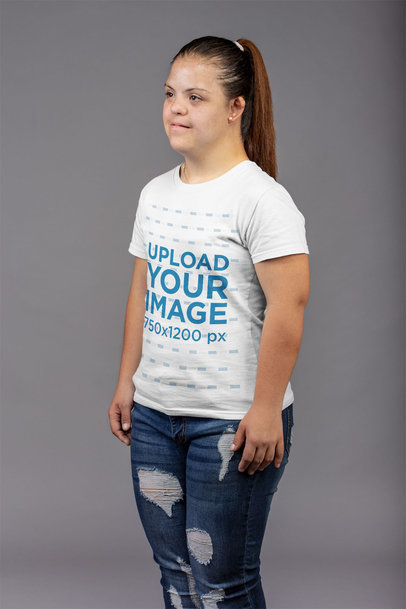 Side View T-Shirt Mockup of a Woman Standing in a Gray Room a21390