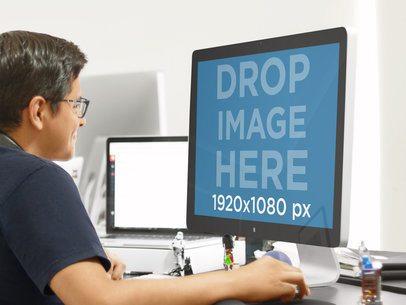 Smart Young Man Using a Mac Thunderbolt at a Modern Office