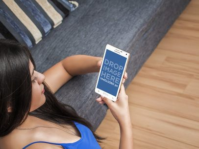 Young Woman Using Android Phone While Relaxing at Home