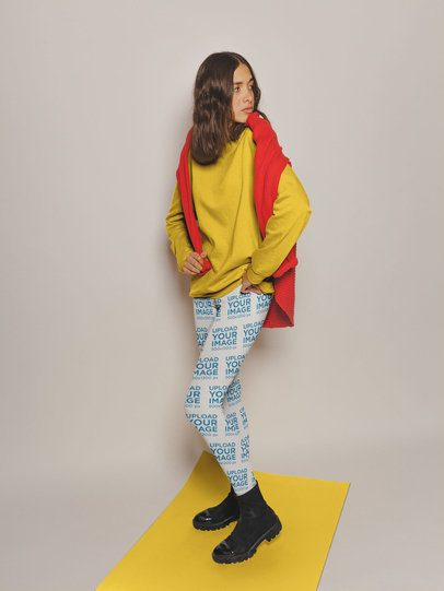 Mockup of a Shy Girl Wearing Leggings and a Sweater Standing on a Pasteboard a19133