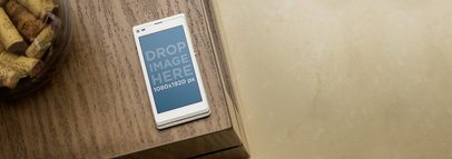 Android Mockup Template of a White Sony Xperia Over a Table