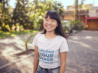 T-Shirt Mockup of an Asian Girl Outside her House a20564