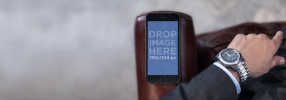 Topshot of Businessman With Black iPhone 6 Mockup Template