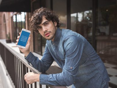 Mockup of a Man with Curly Hair Holding a Gold iPhone 8 Plus 21597