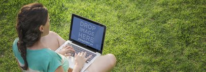 Macbook Pro Mockup of a Girl Sitting on the Grass