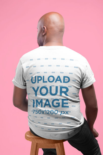 Tshirt Mockup Featuring the Back of a Man Sitting on a Stool 20784