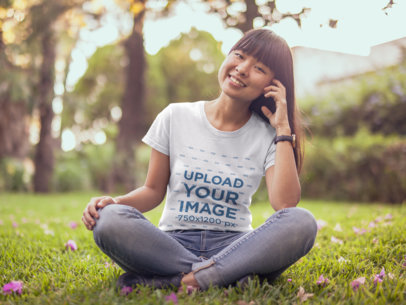 Mockup of a Happy Girl Wearing a Round Neck Tshirt at a Park 20578