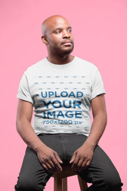 Mockup of a Serious Man Wearing a Tshirt Sitting on a Stool 20786
