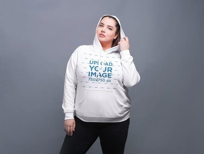 Mockup of a Woman Wearing a Plus Size Pullover Hoodie 21023