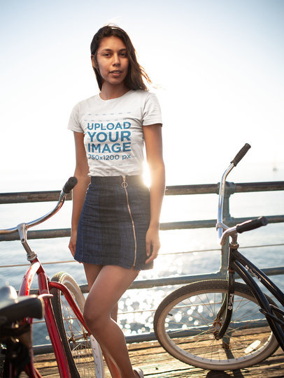 T-Shirt Mockup of a Woman at a Pier with Two Bikes 18323