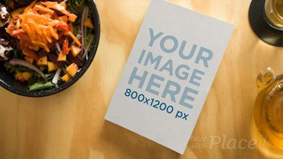 Book Video Lying on a Wooden Table with Healthy Food Surrounding It 14176
