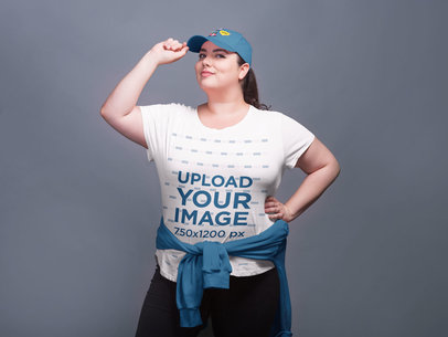 Plus Size T-Shirt Mockup of a Woman with a Sweatshirt Tied Around Her Waist 21029