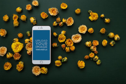 Gold iPhone 8 Plus Mockup Lying Surrounded by Yellow Flowers 21753