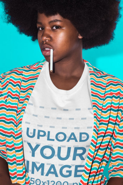 Tee Mockup Featuring a Portrait of a Girl with a Cigarette and Afro Hair Against a Vivid Cyan Background 21714