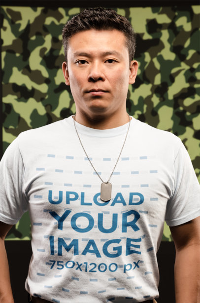 T-Shirt Mockup of a Veteran Man in Front of a Camouflage Background 21253