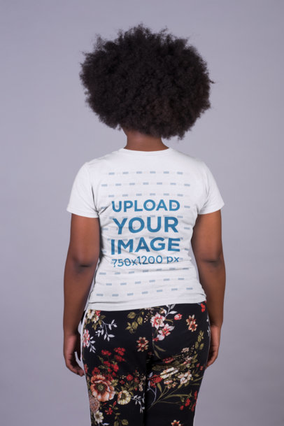 Back Shot of a T-Shirt Mockup Featuring a Woman in Patterned Pants 21720